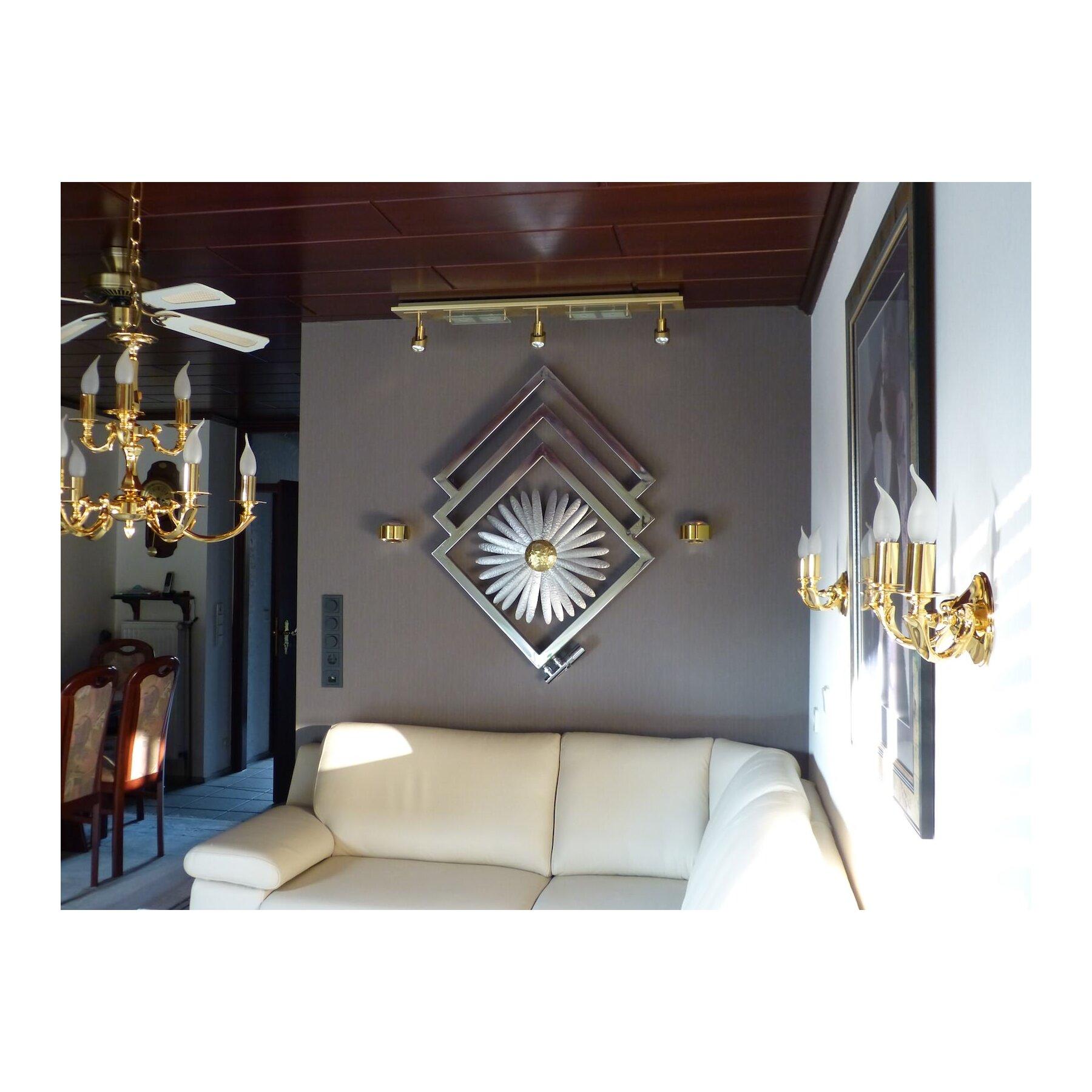designheizk rper mit blumenskulptur. Black Bedroom Furniture Sets. Home Design Ideas